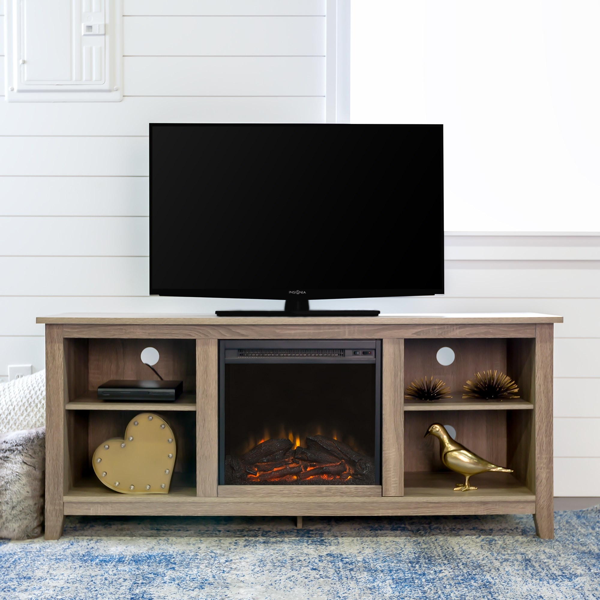 The TV stand with an electric fireplace in the middle and two shelves on either side