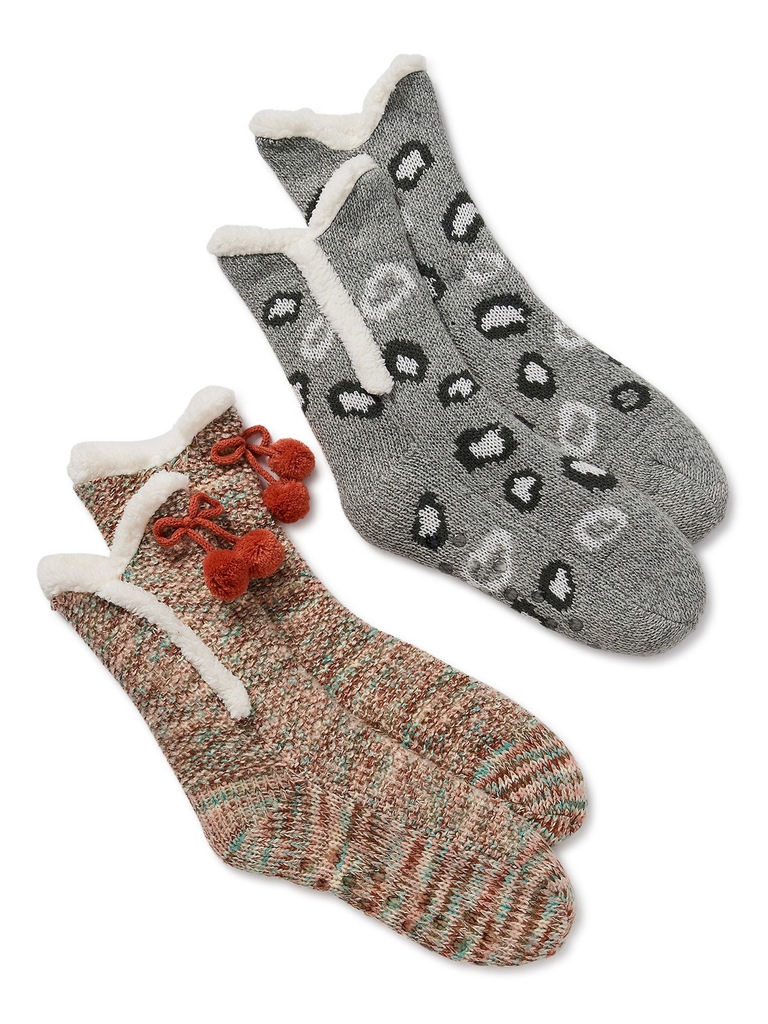 Two pairs of the cozy socks with a plush lining in a multi-colored print and a black and grey leopard print