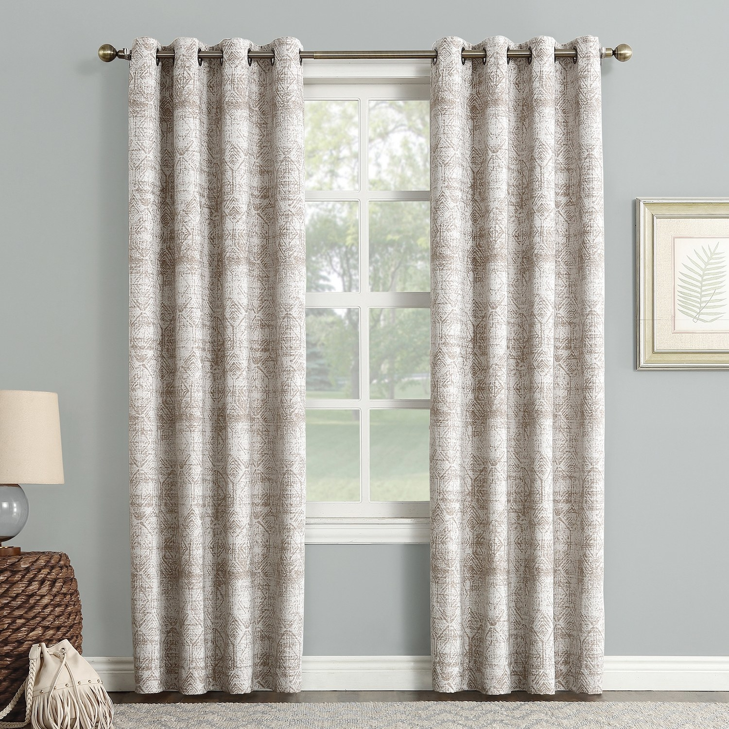 The beige blackout curtains with a geometric pattern hanging over a window