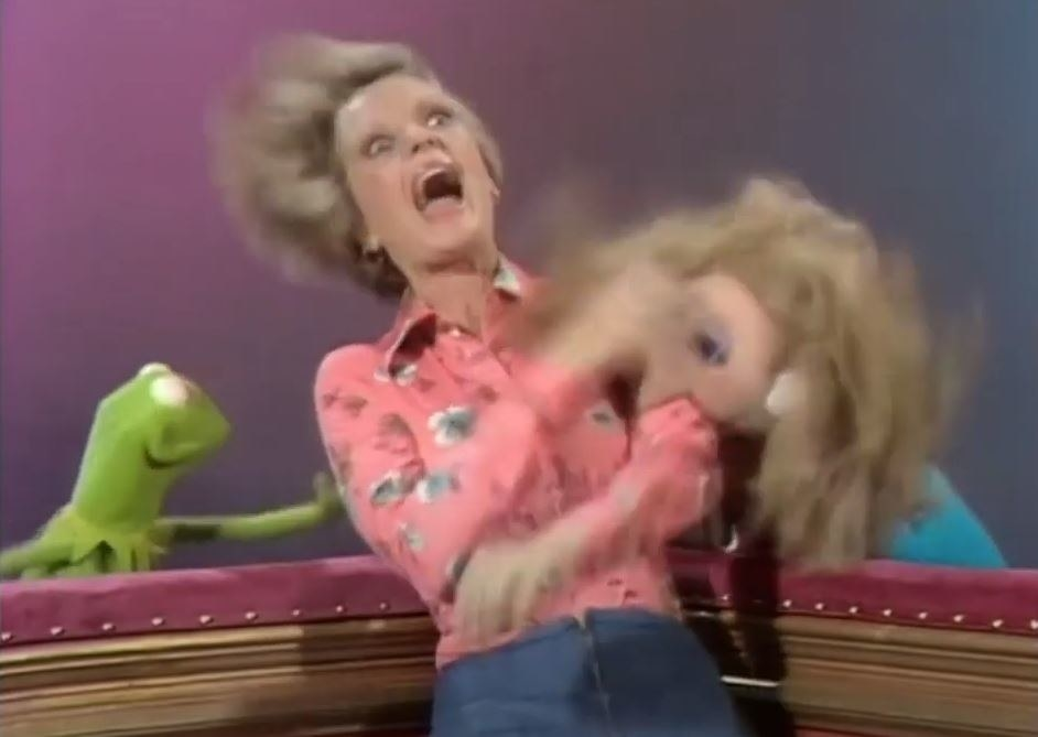 Miss Piggy Attacks Florence Henderson as Kermit watches