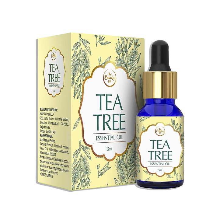A bottle of tea tree oil next to the packaging
