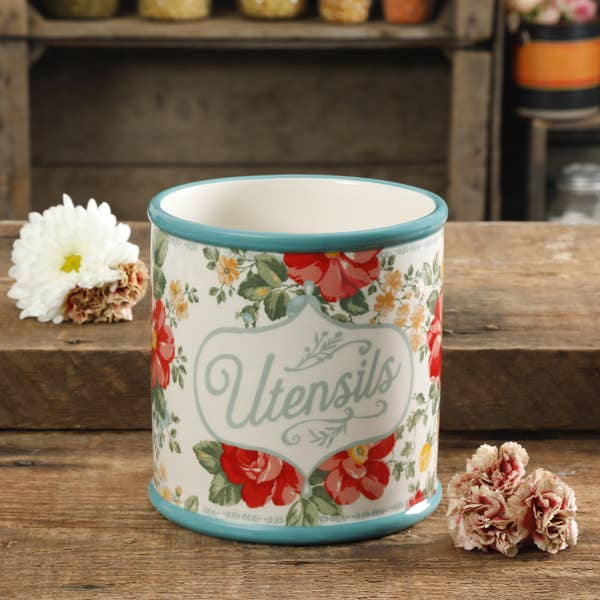 The Pioneer Woman floral kitchen utensil holder sitting on a table