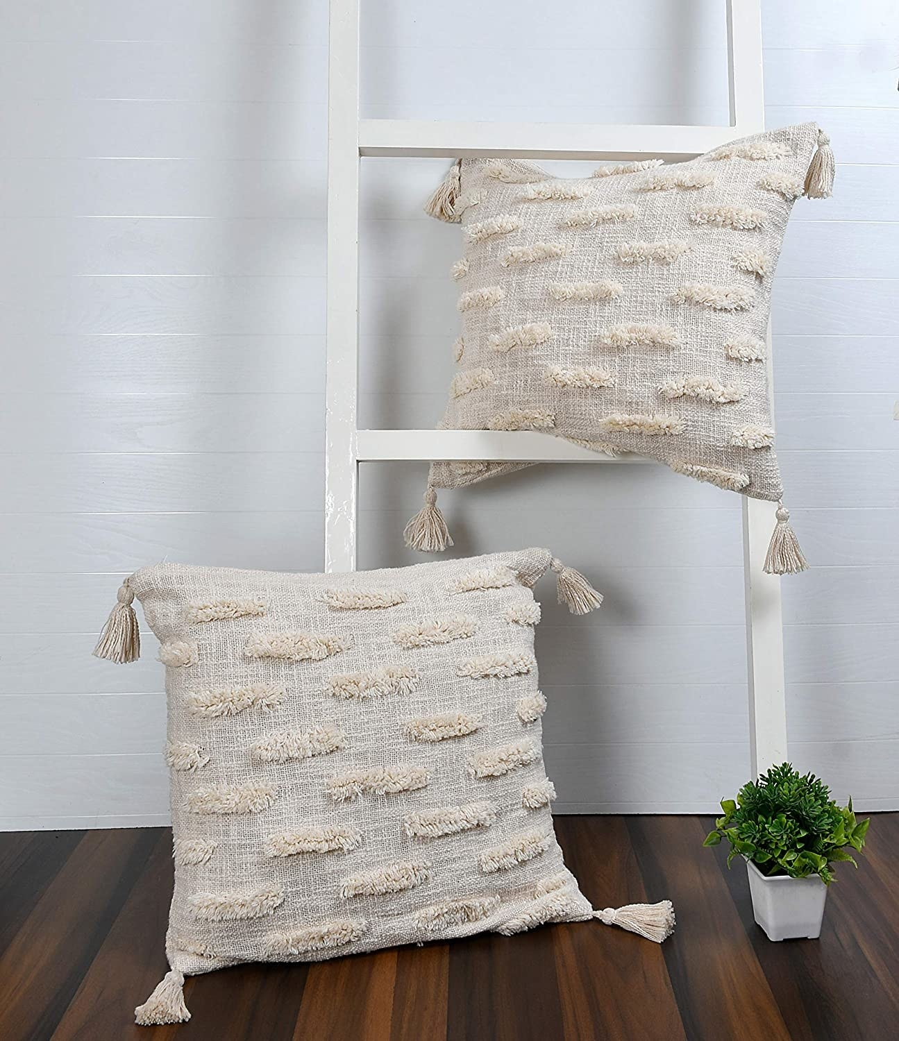 Pillows arranged on and in front of a ladder.