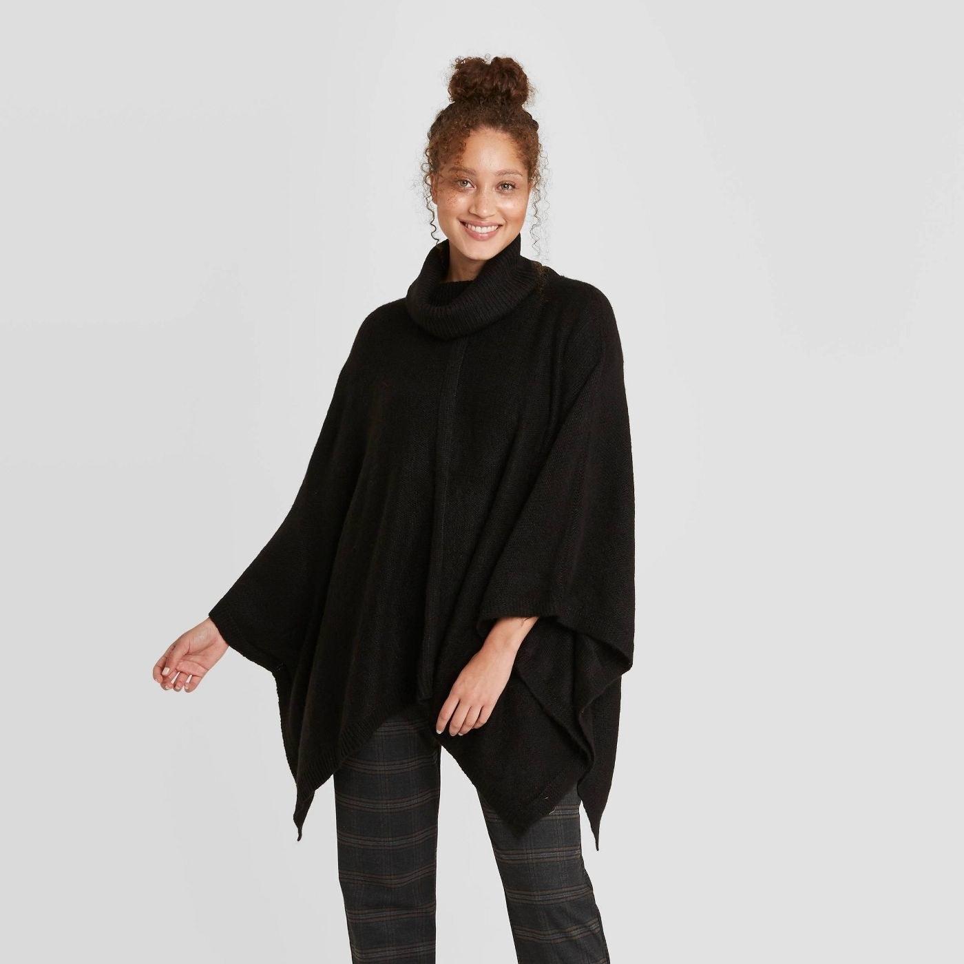 Model in black poncho