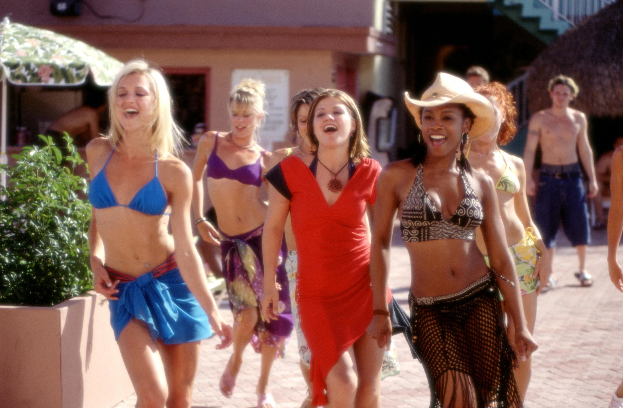 Alexa, Kelly, and Kaya strutting on the beach