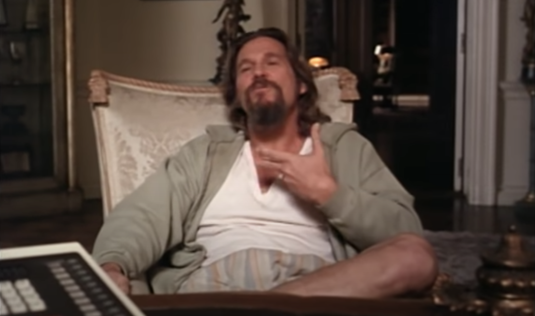 Jeff Bridges lounging in a chair as The Dude