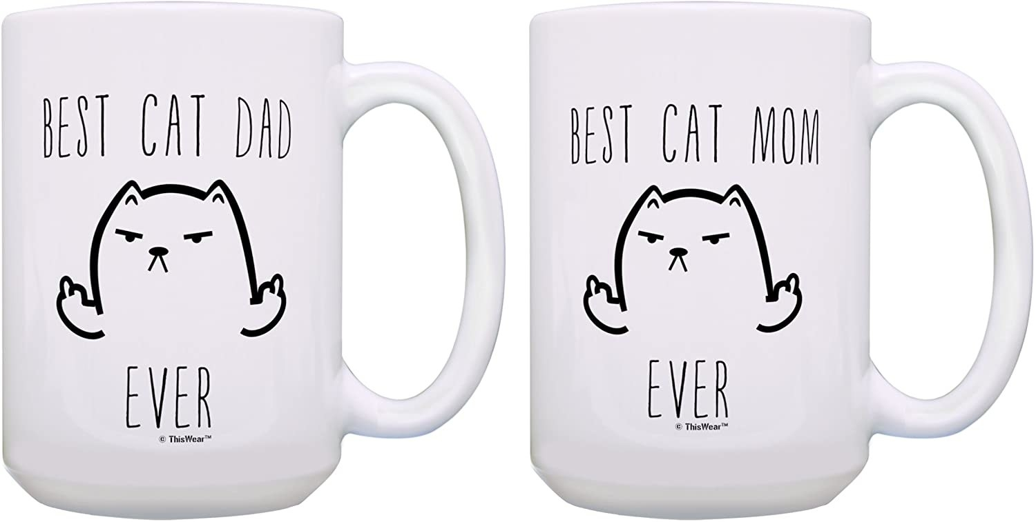 Matching white mugs that say best cat dad ever and best cat mom ever with a cat with its middle finger up