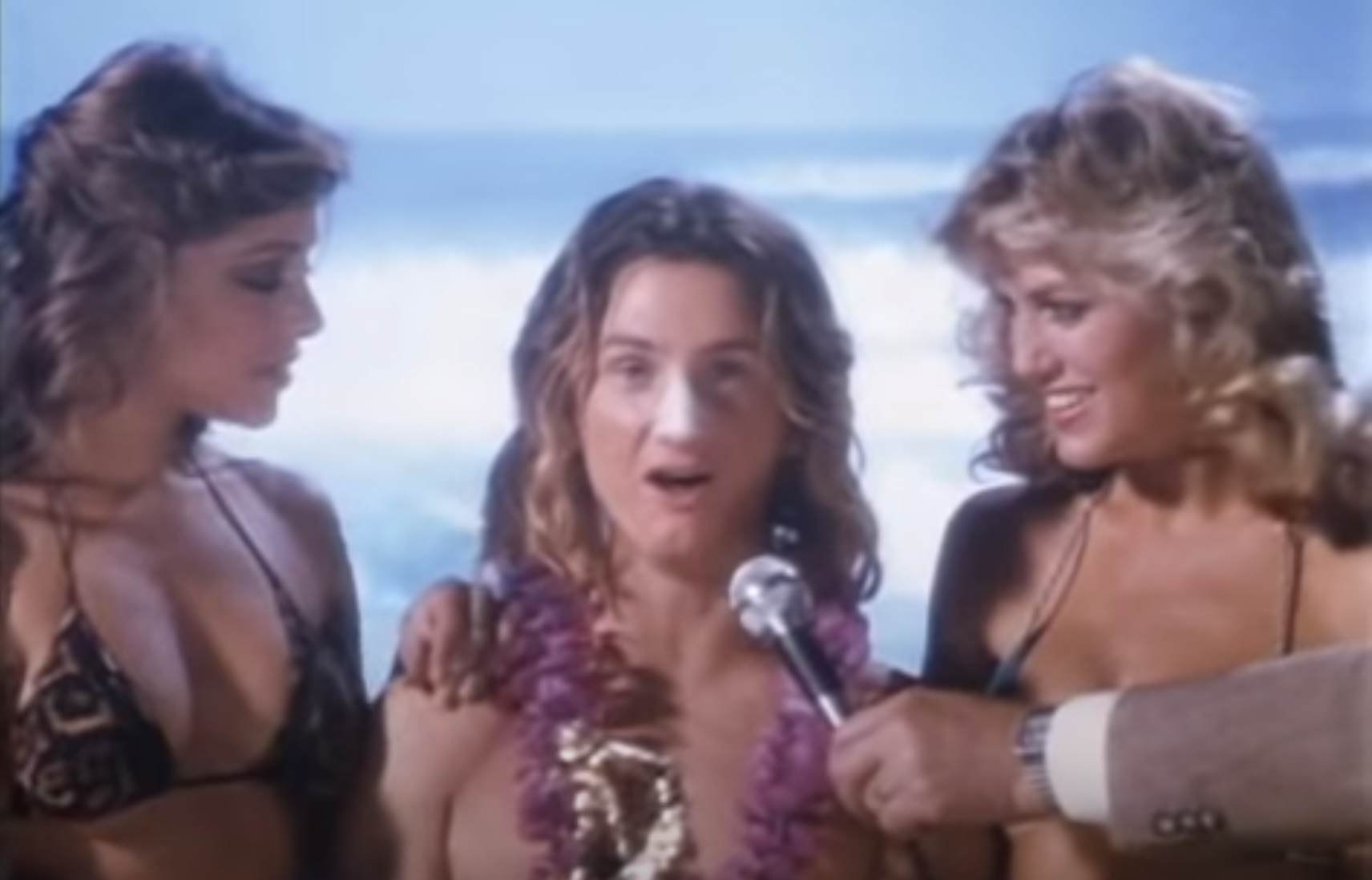 Spicoli at the beach with two women