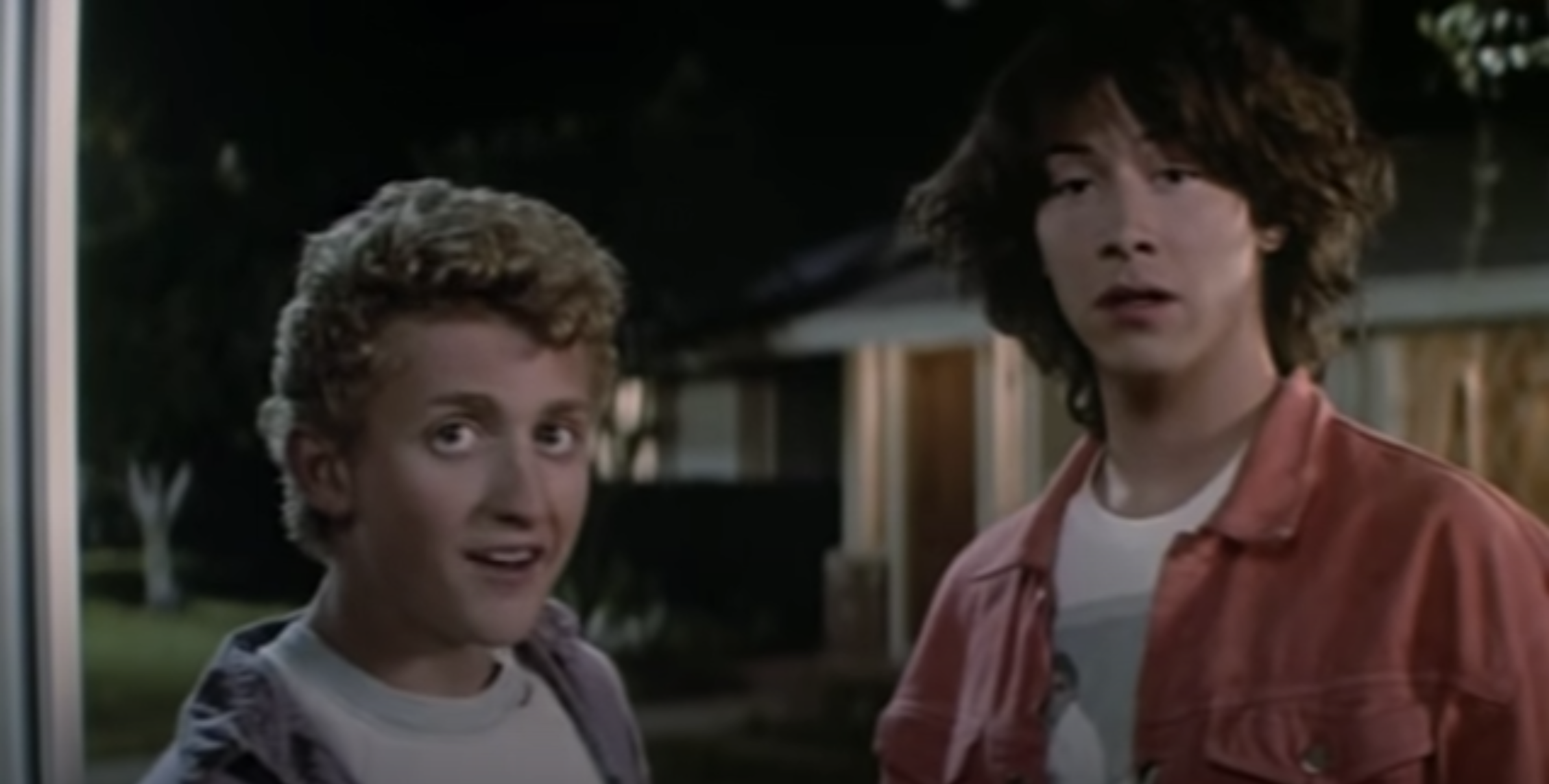 Bill and Ted standing at someone's door