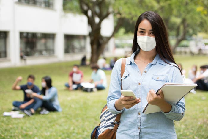 College student wearing a face mask on campus