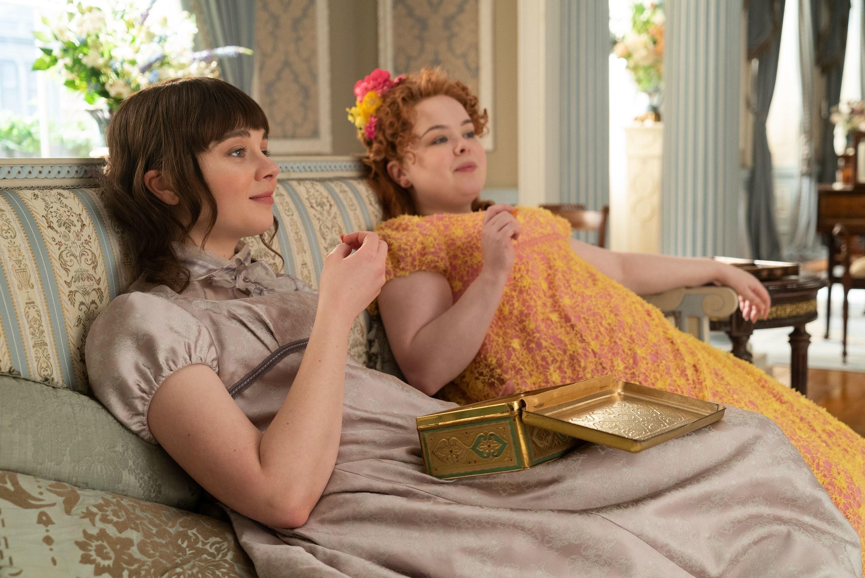 "Eloise and Penelope eating chocolates in ""Bridgerton"""