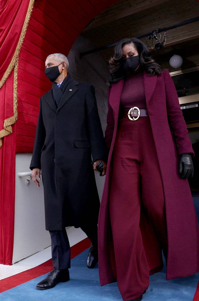 Former US President Barack Obama and wife Michelle Obama arrive for the inauguration of President-elect Joe Biden, with Michelle in her iconic designer suit