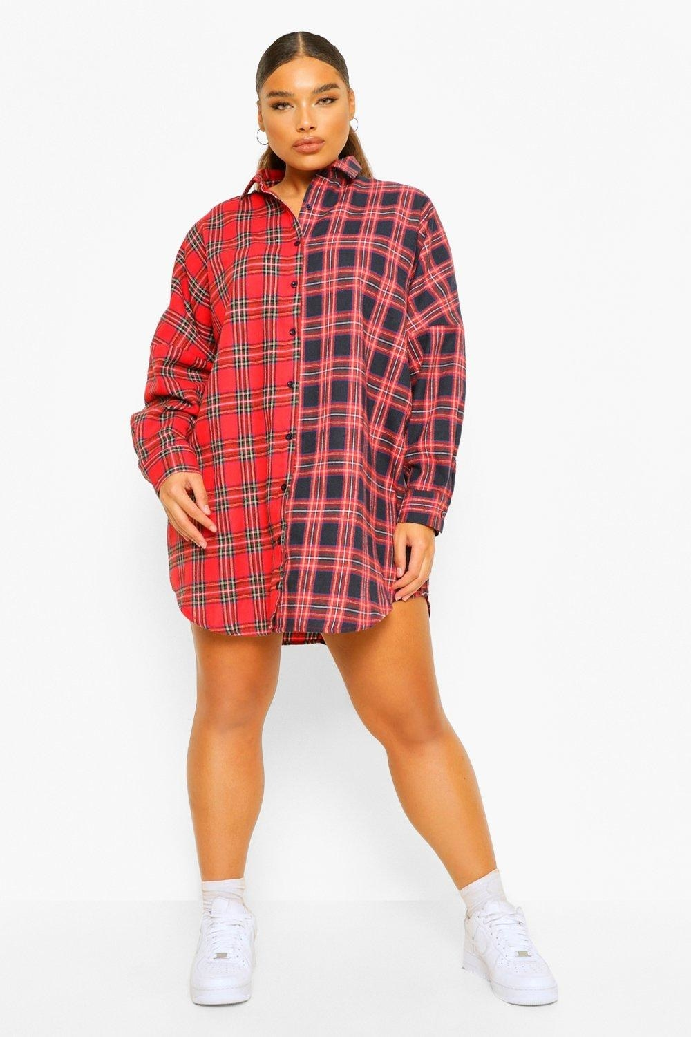 Model wears red, pink, and black check button-front dress with white sneakers