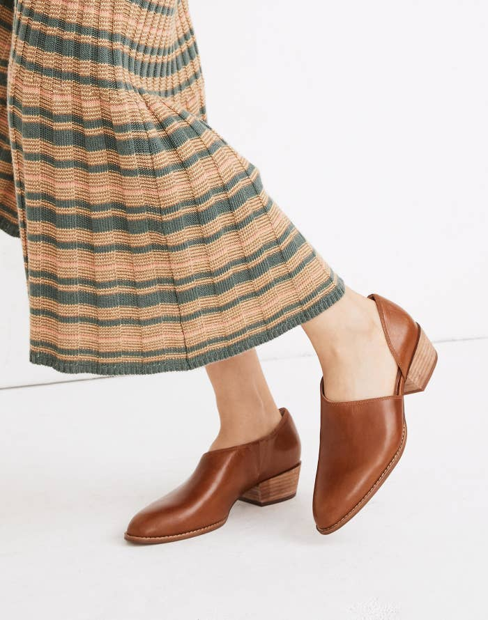 reviewer wearing the bootie with the cut-outs on the sides in brown
