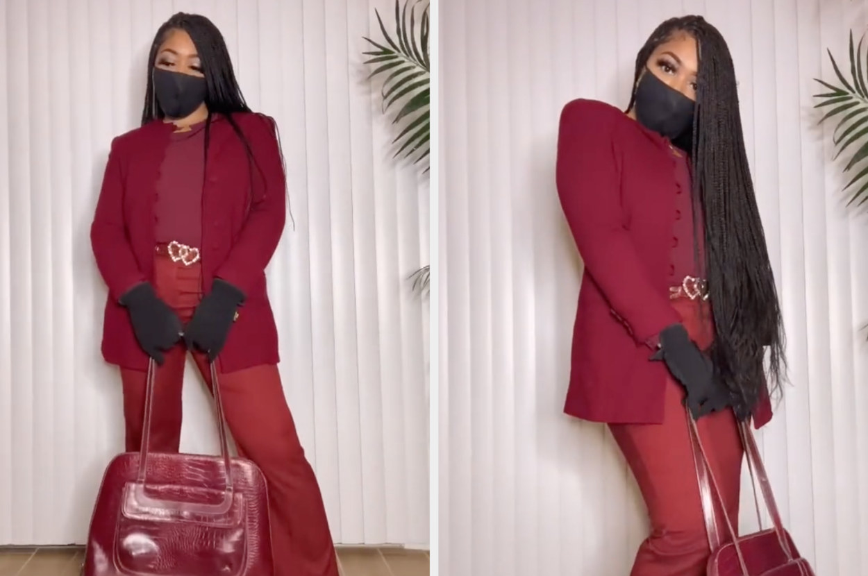 Iesha poses in her final outfit: a matching jacket and top, trousers, and matching purse, as well as black gloves and a black mask — just like Michelle Obamas's outfit