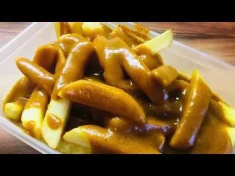 Beautiful chips covered in curry sauce.