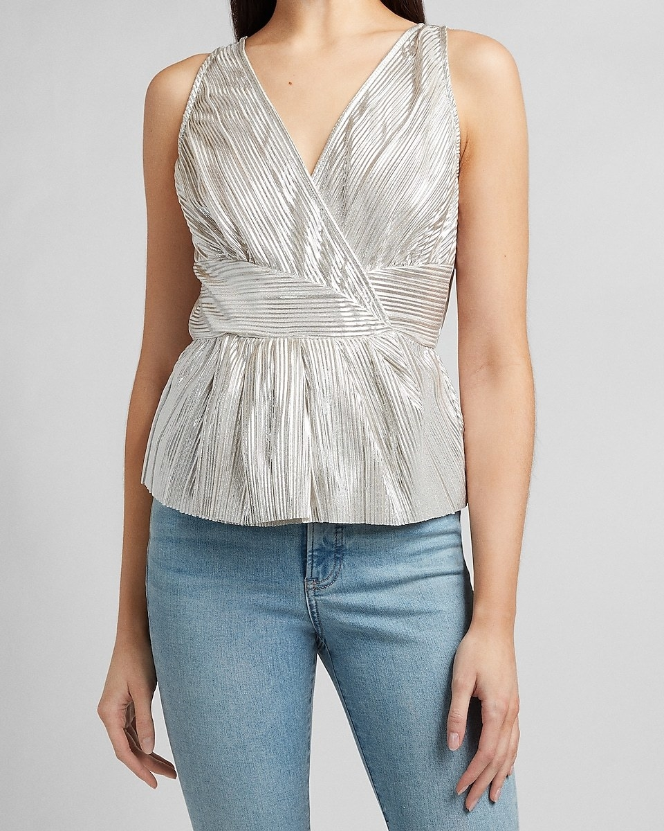 model in the v-neck, faux-wrap silver top