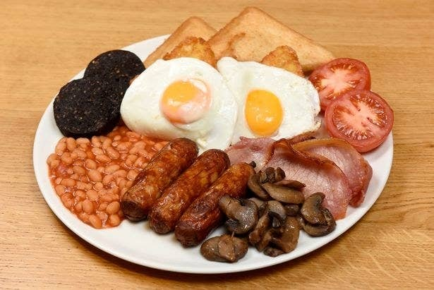 A full English with toast, egg, tomato, bacon, mushroom, sausage, beans and black pudding.
