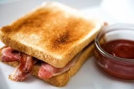 toast and bacon in a sandwich.