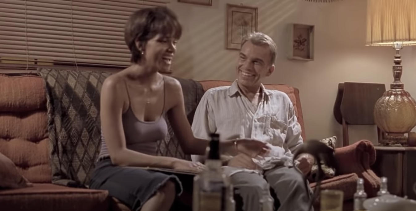 """Halle Berry and Billy Bob Thornton laughing on the couch together in """"Monster's Ball"""""""