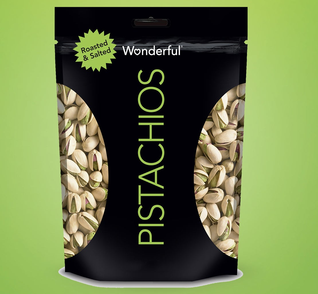 bag of wonderful pistachios on a green background