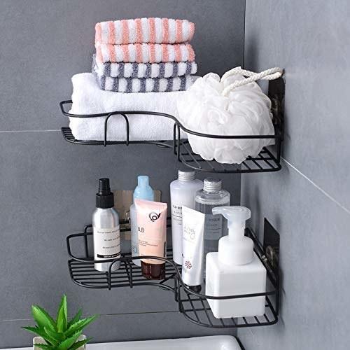 Black metal corner racks with toiletries and towels.