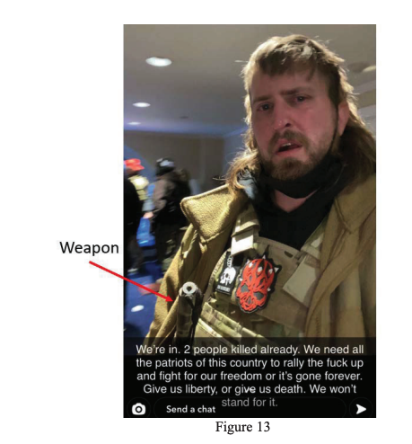 "Selfie of a man in a tactical vest with an arrow pointing to a weapon on his person. His caption says ""We're in,"" ""We need all the patriots of this country to rally the fuck up and fight for our freedom,"" and ""Give us liberty, or give us death"""