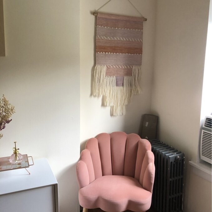 Reviewer's picture of the seashell-backed chair in pink