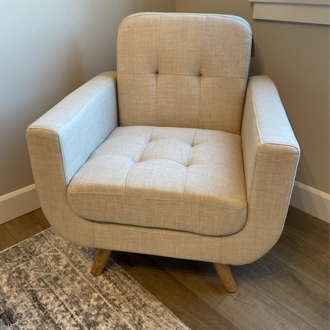 Reviewer's picture of the cream colored fabric arm chair
