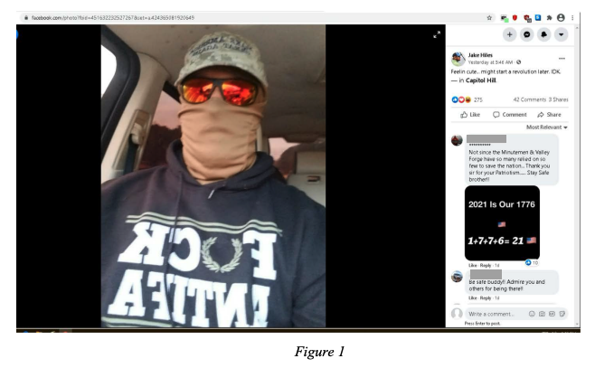 "Selfie of a man in sunglasses, a ""Fuck Antifa"" shirt, and face covering"