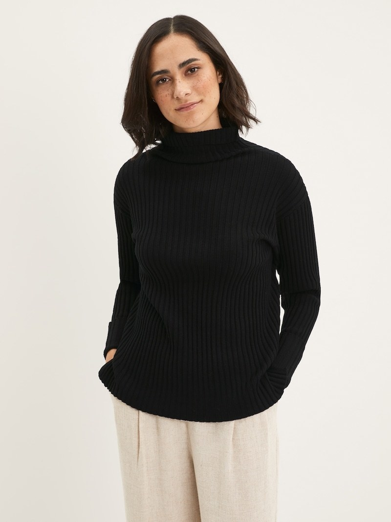 model wearing the black sweater