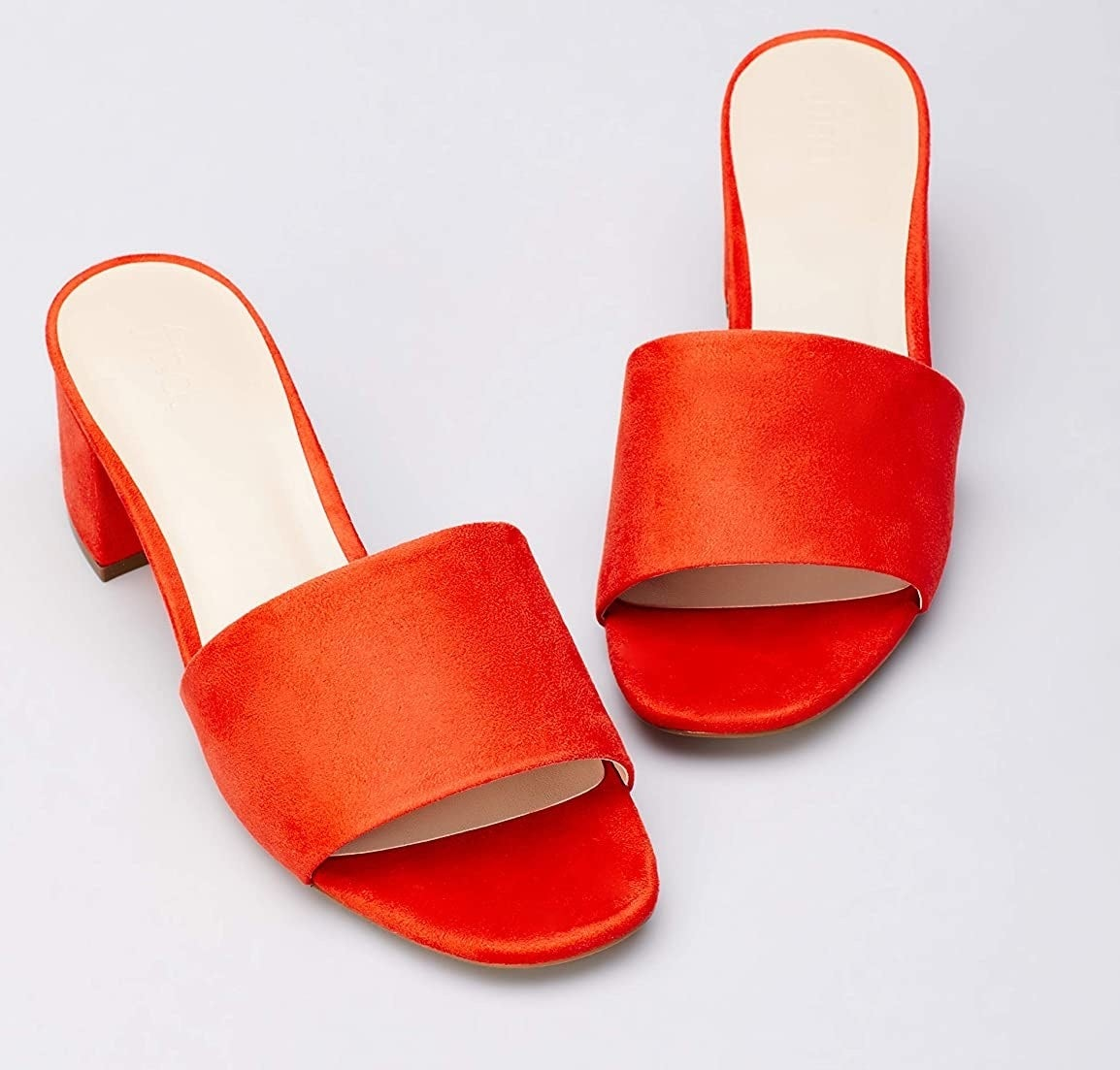 the open-toe sandals in bright red