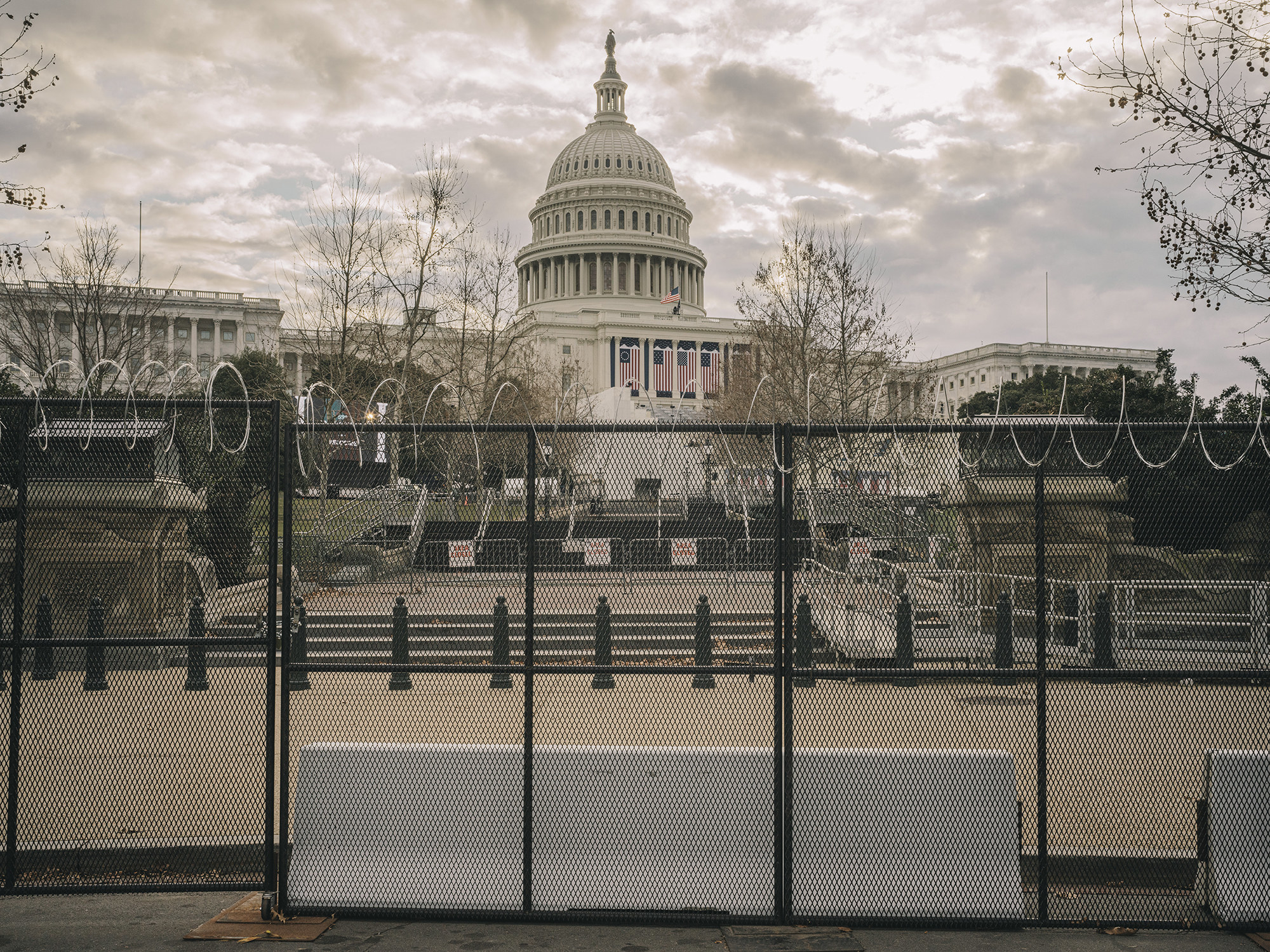 A view of the Capitol building through barricades