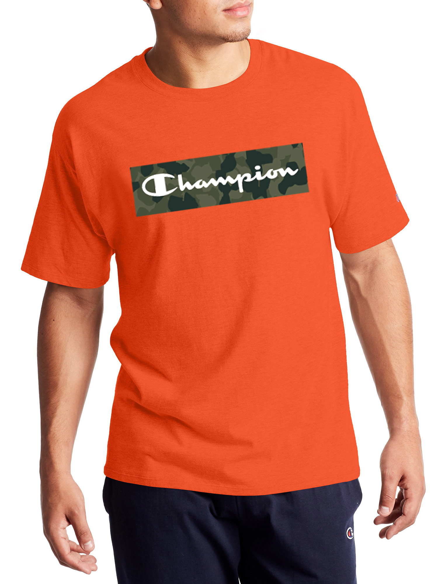 orange champion t shirt with a camo graphic design