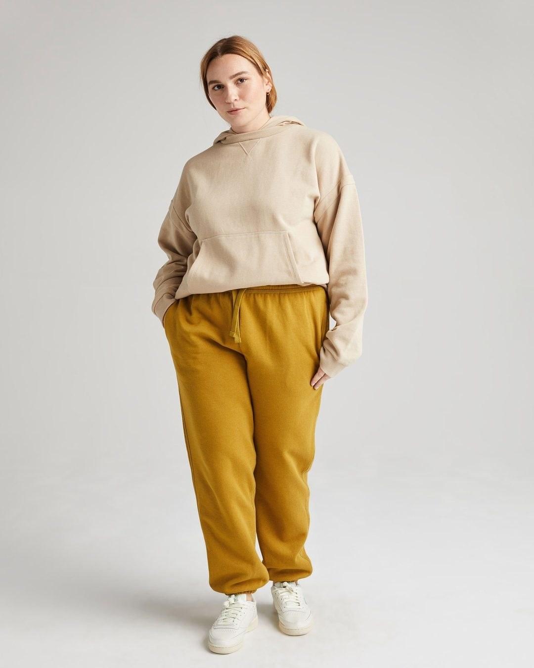 model wearing the golden yellow sweatpants