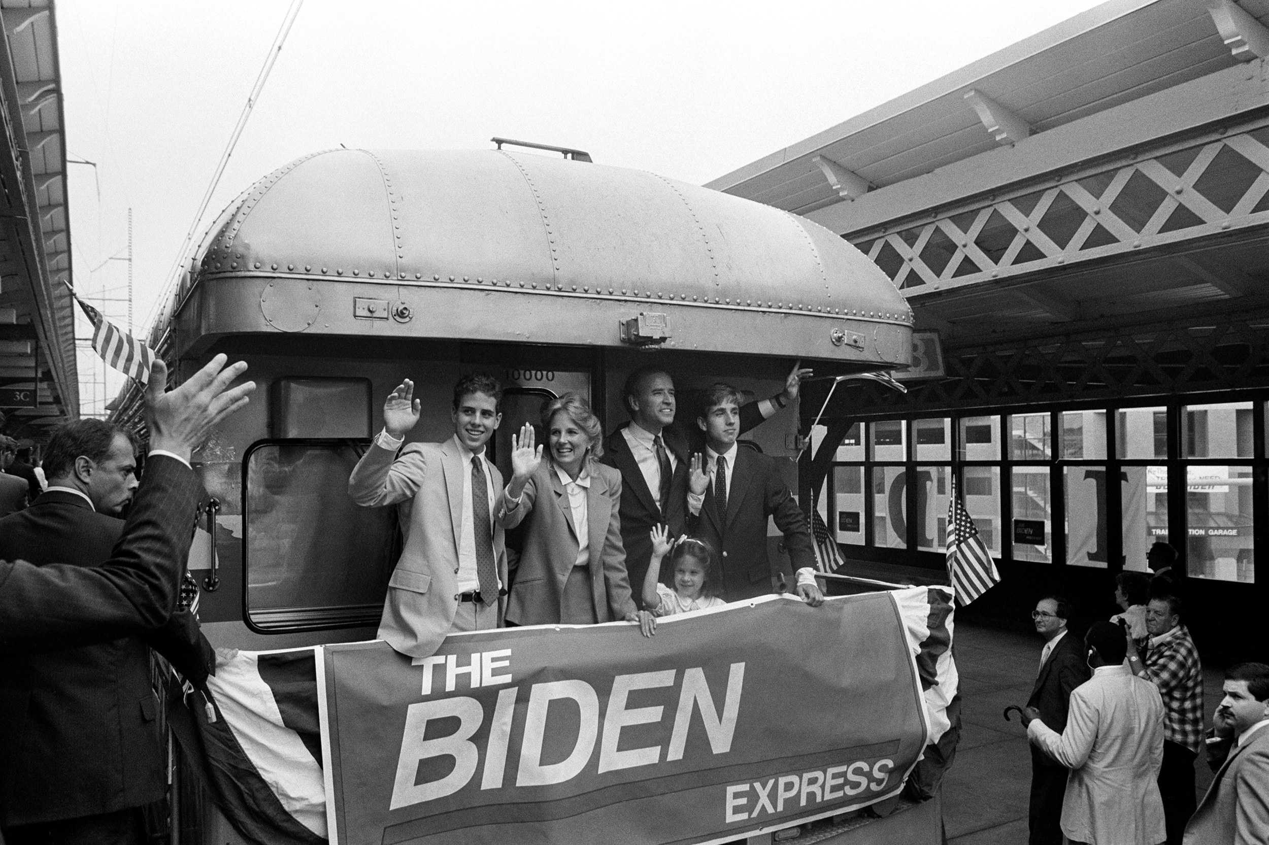 An archival image of the Bidens on a bus in the 80s