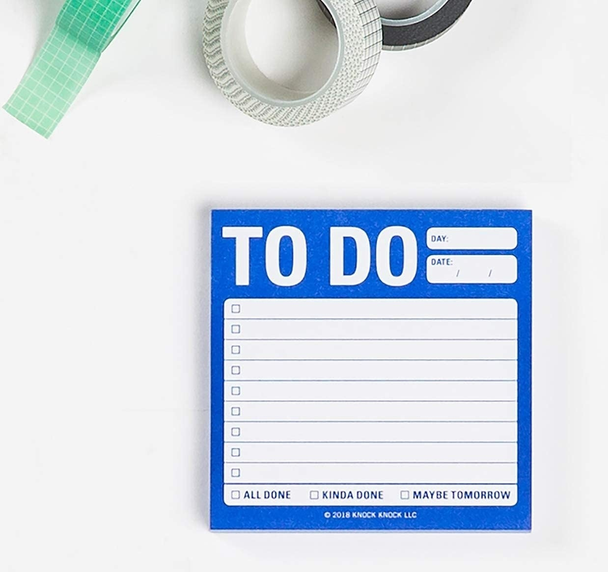 A lined notepad on a plain background