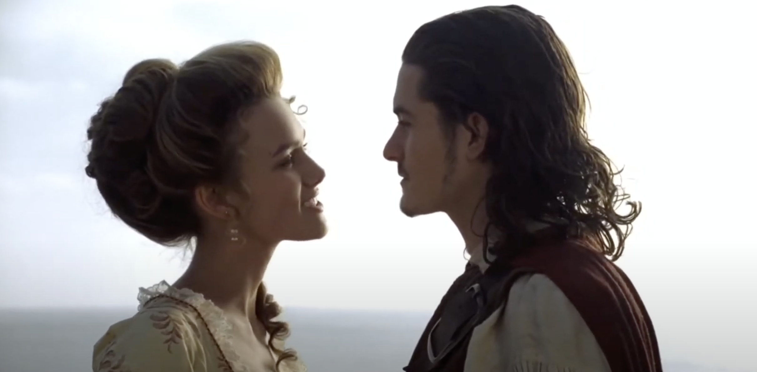 """Keira Knightly and Orlando Bloom looking at each other in """"Pirates of the Caribbean"""""""