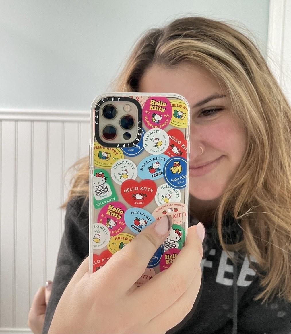 Ali Faccenda taking mirror selfie with hello kitty phone case