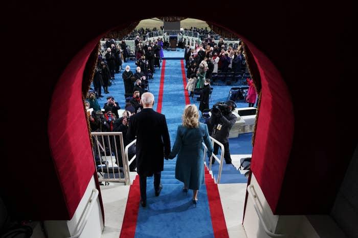 Joe and Jill Biden entering the Inauguration through a doorway