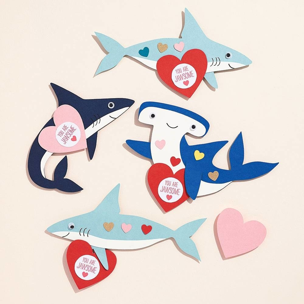 cut-out sharks with googly eyes holding hearts that say you are jawsome