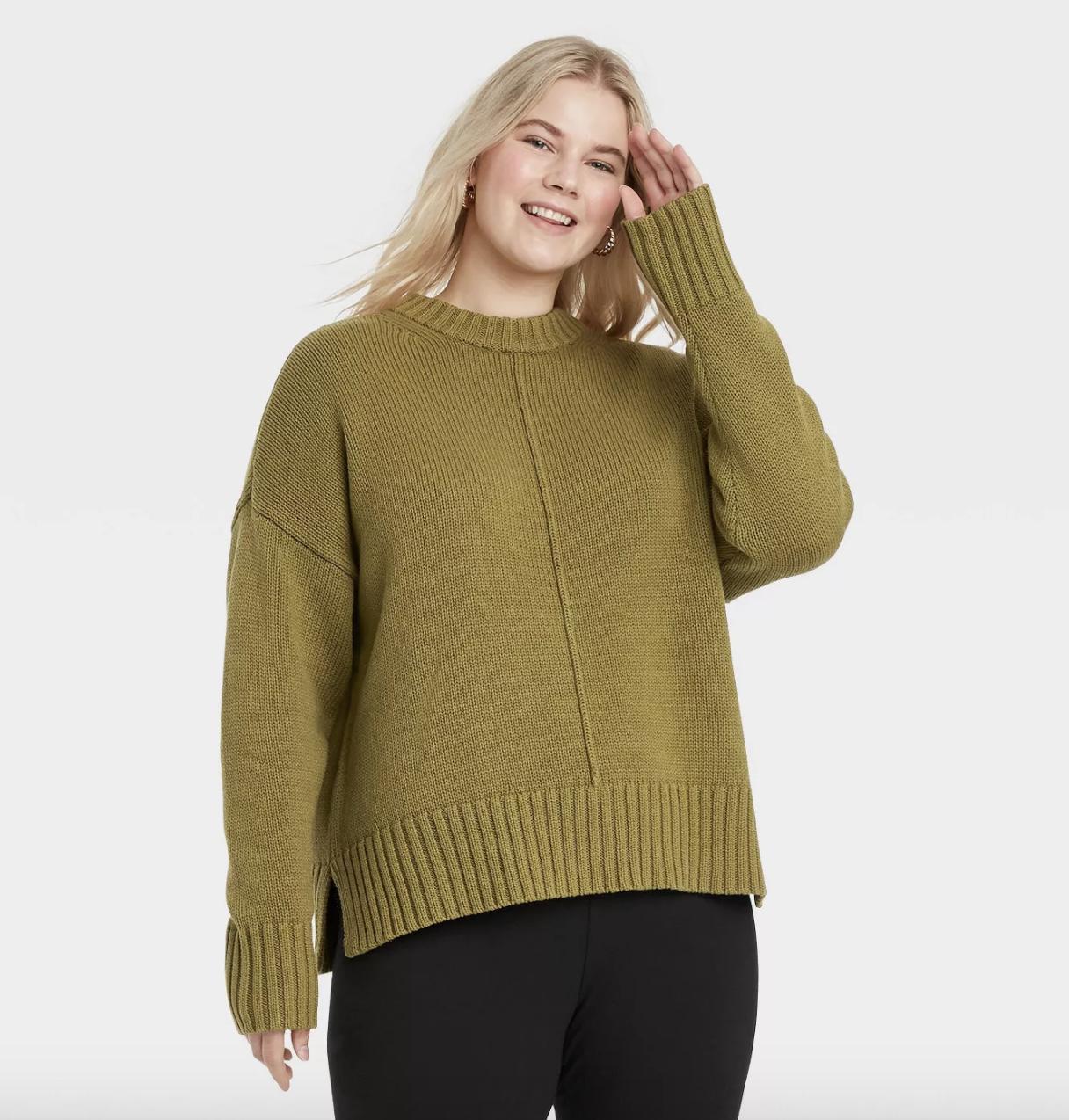 model wearing the light green sweater