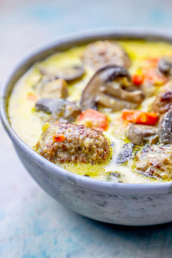 Creamy soup with meatballs, carrots, and mushrooms.