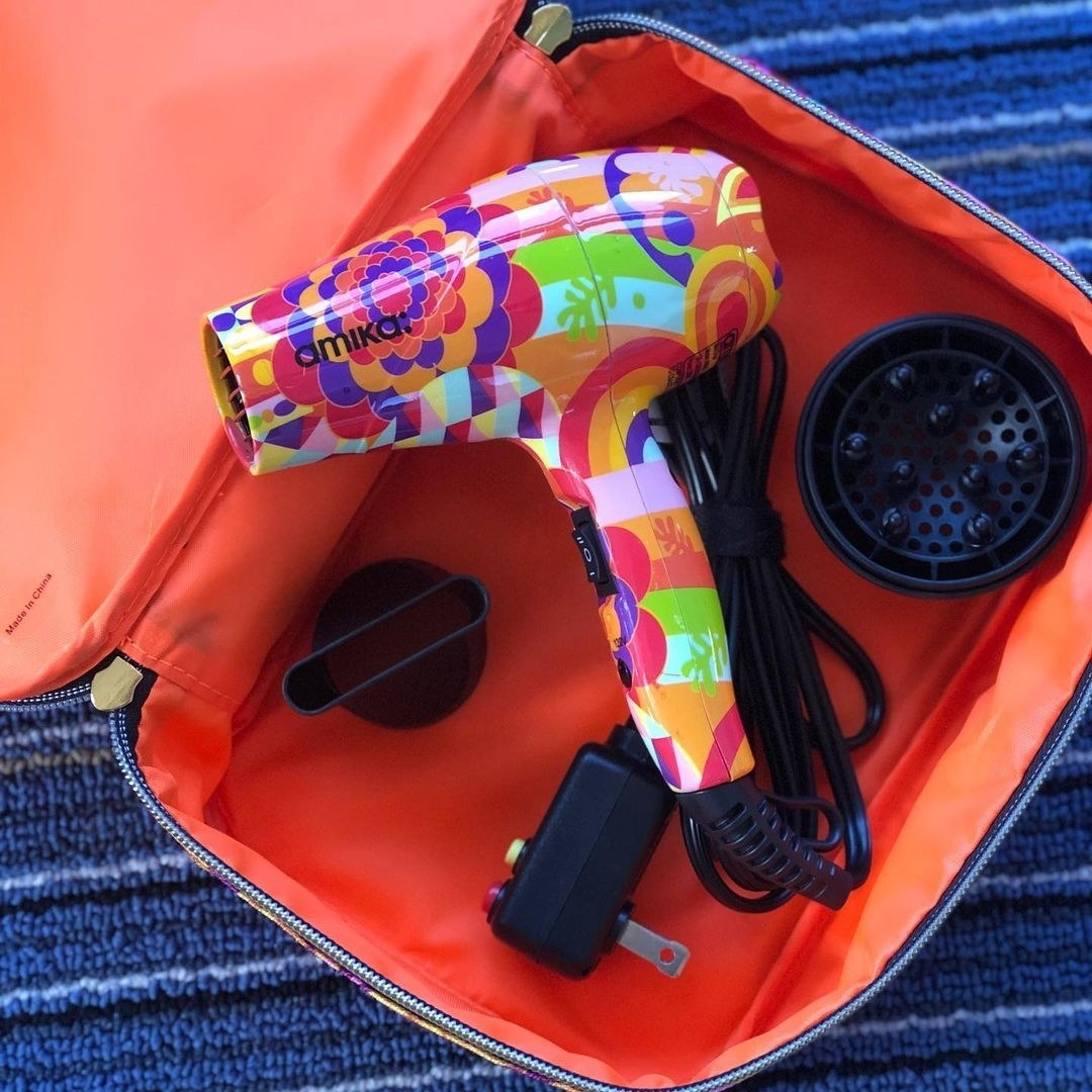 The mini hair dryer in the carrying case with two attachments