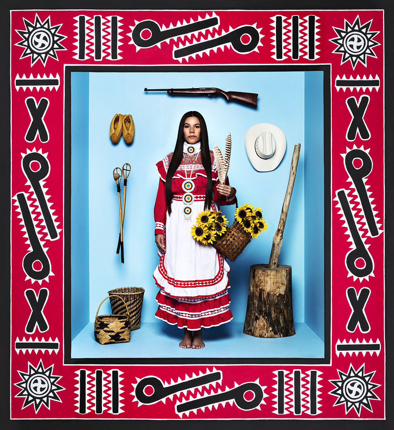 A Native American woman surrounded by pioneering items and a colorful border