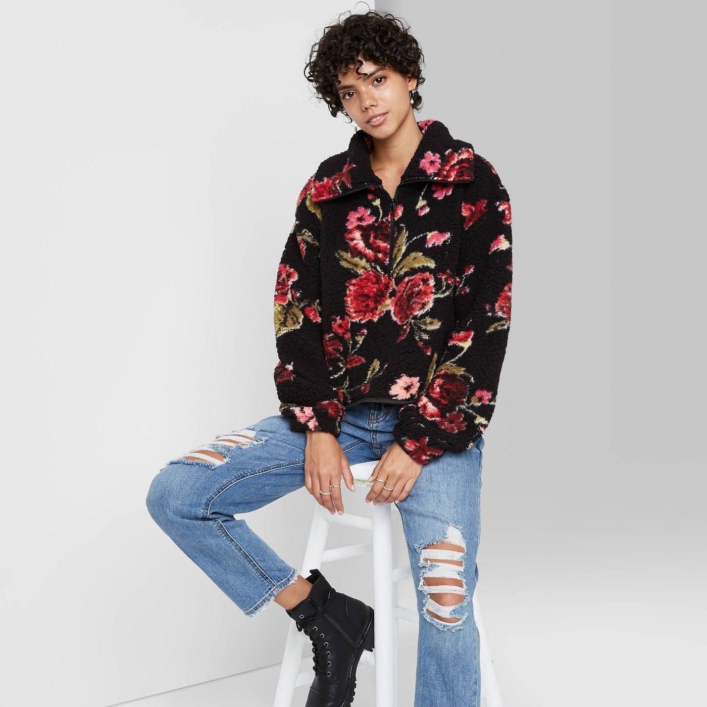 Model in quarter zip sherpa pullover