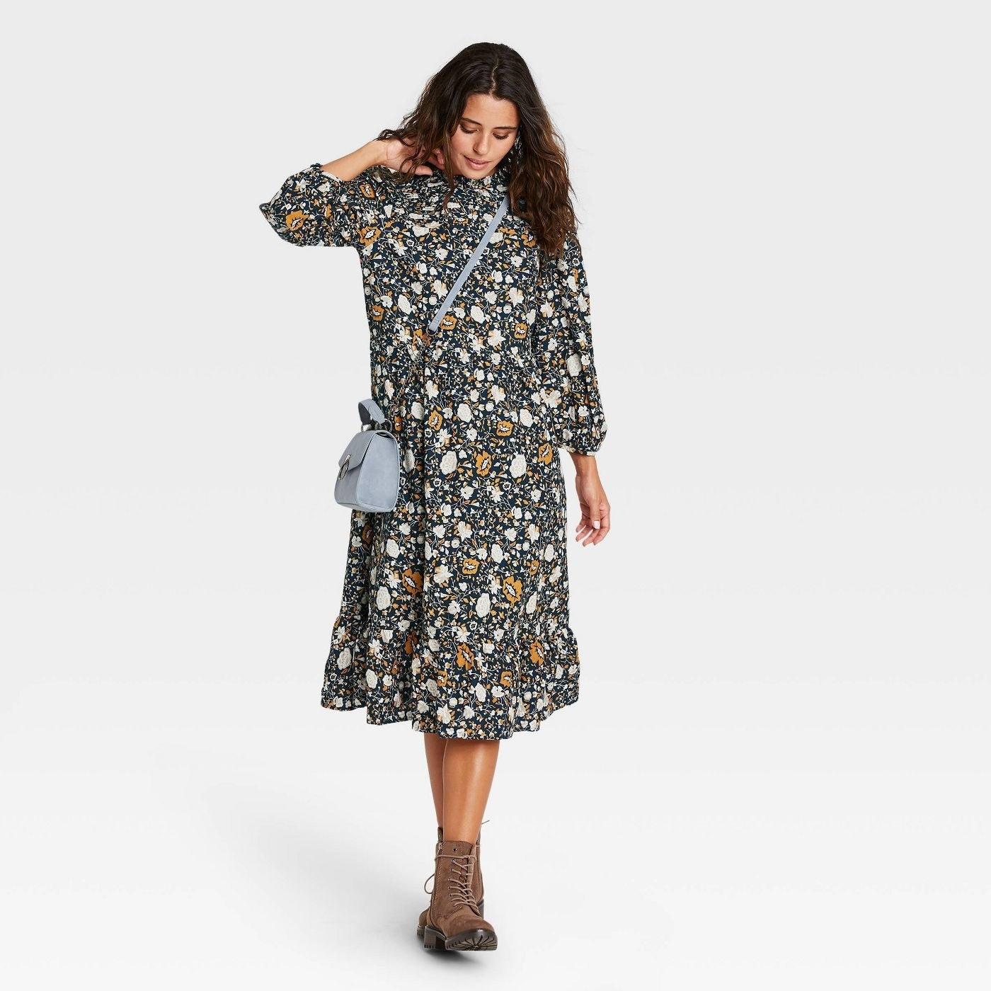 Model in long sleeve dress