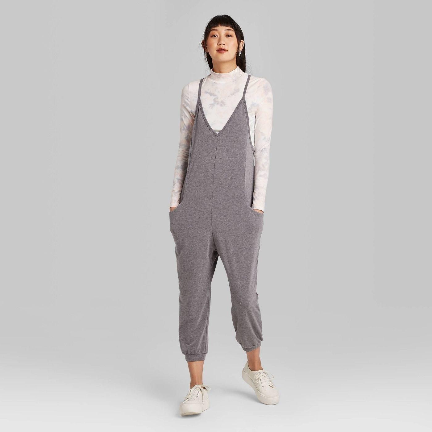 Model in sleeveless v-neck knit jumpsuit