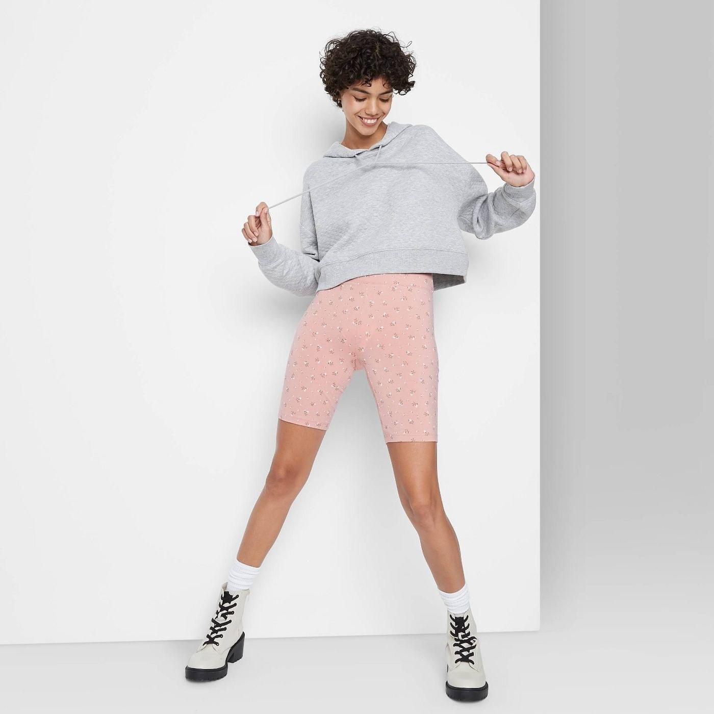 Model in high-rise bike shorts