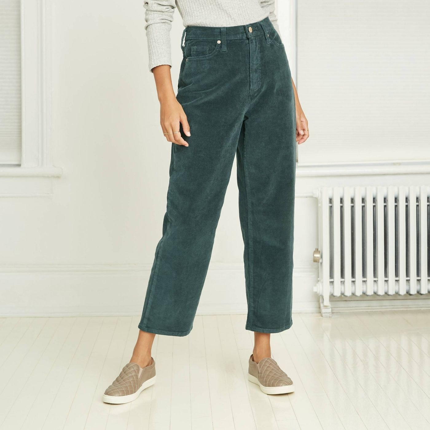 Model in high-rise cropped corduroy pants